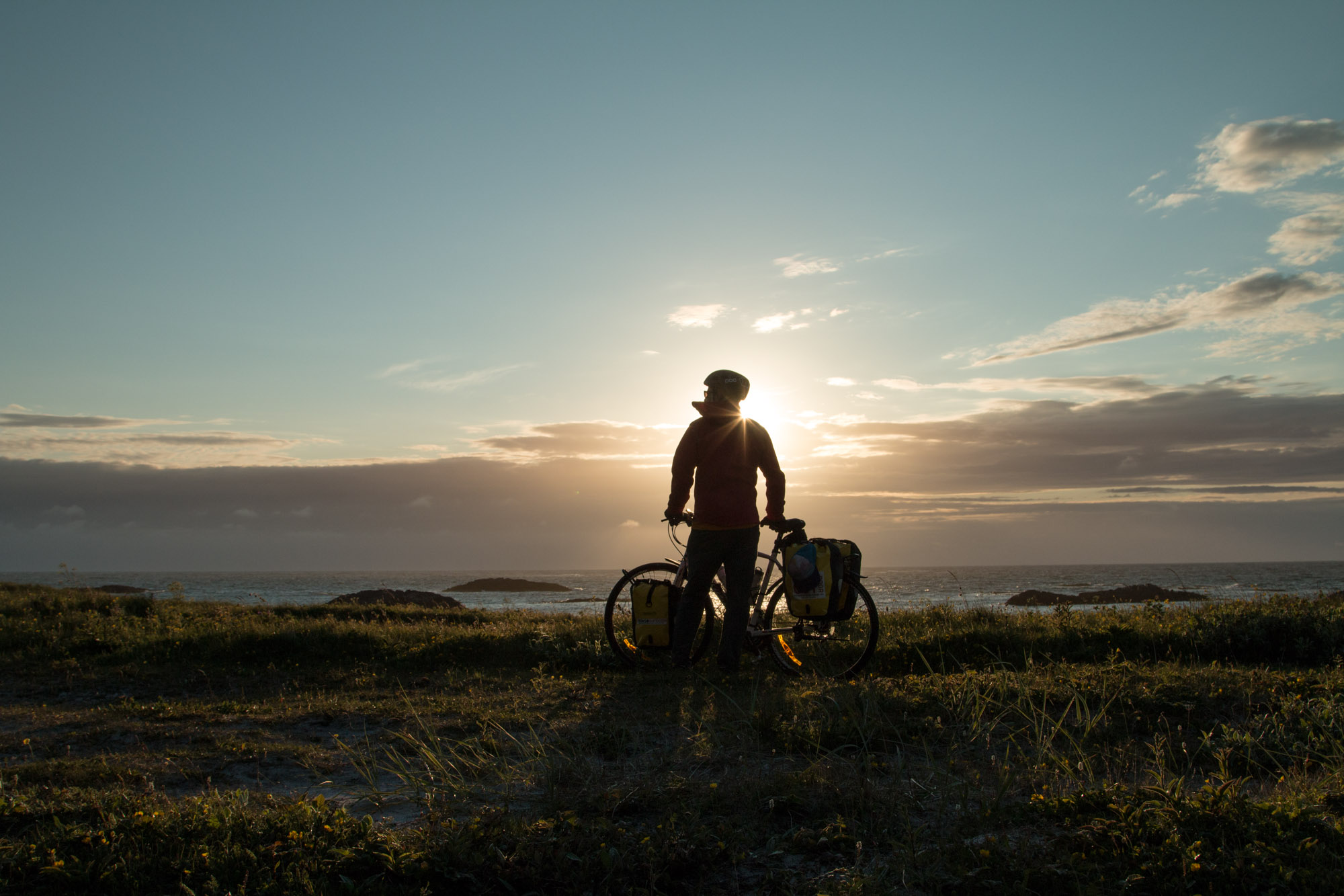 Brendan Leonard looks out at the Norwegian Sea from a beach outside Andenes on the seconde night of a bike tour in northern Norway.